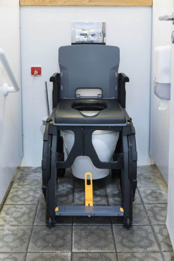 Shower chair on toilet with commode